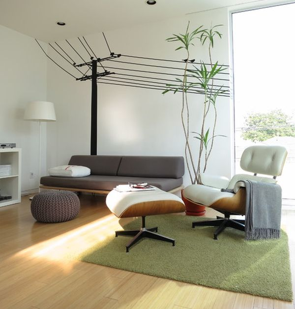 Cool wall decals make a beautiful backdrop for the Eames Lounge and Ottoman