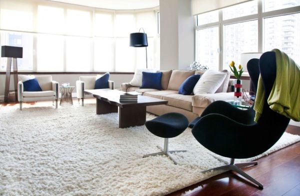 Couch cushions that match the color of the Egg chair make for a beautiful and bold addition