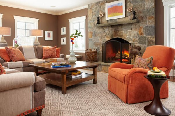 Couch in orange makes for an interesting visual when placed near a fireplace