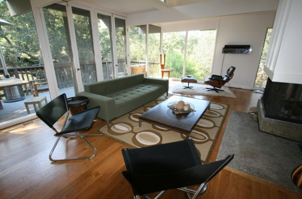Create a relaxed family area with a couch and the Eames Lounger