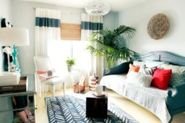 Custom designed drapes and blinds give this bedroom a vacation suite style!