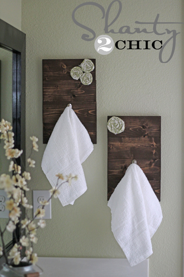View In Gallery Dark Wood Towel Hooks With Fabric Rosettes With Modern Bathroom  Towel Rack.
