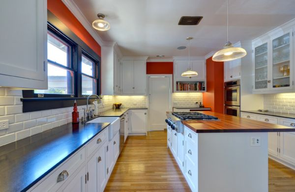 Dash of orange in the kitchen to complement the white backdrop
