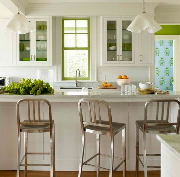 Dishware, painted window frame and fresh veggies add green to the kitchen subtly