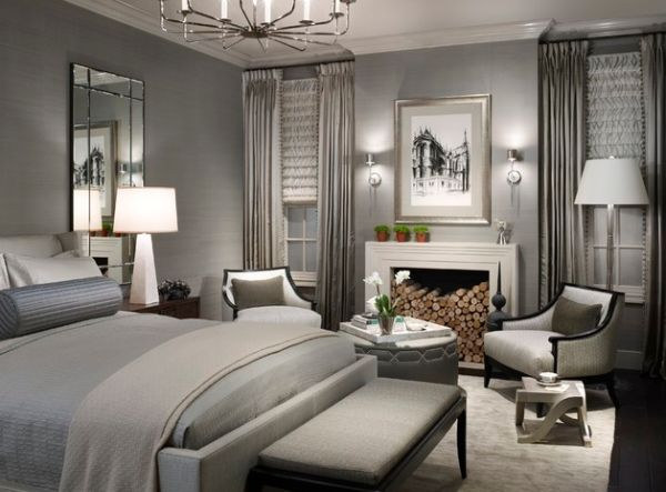 Donghia floor lamp along with table lamp and a lovely chandelier illuminate this exqusite contemporary bedroom