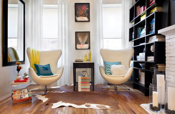 Double egg chairs with colorful cushions for an eclectic setting