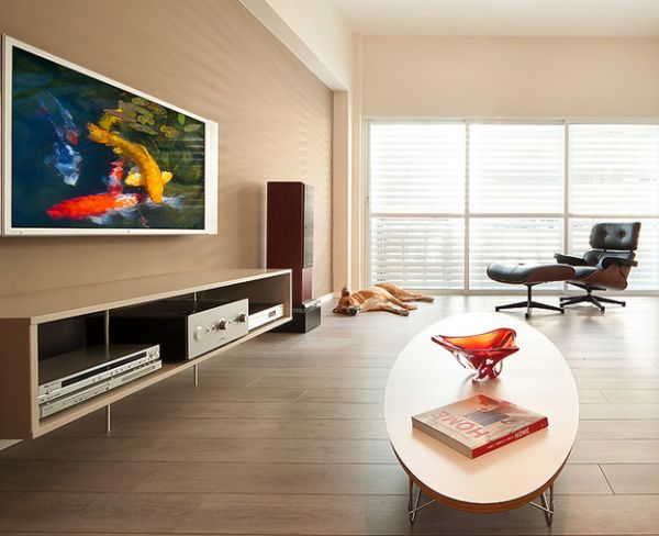 Eames elliptical table gives company to the lounger in this clean and organized living room