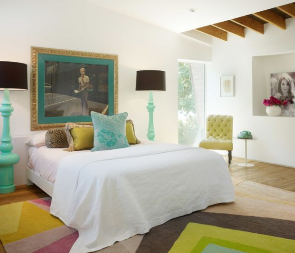 Eclectic bedroom with matching floor lamps in turquoise blue