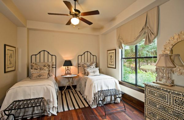 Elegant bedroom with table lamp between the beds stealing the spotlight!
