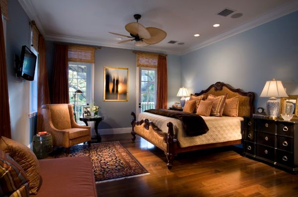 Exquisite and tranquil master bedroom uses bamboo blinds to enhance the luxury retreat-like ambience