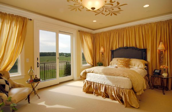Exqusite bedroom exudes rich golden hues that make for warm and inviting interiors
