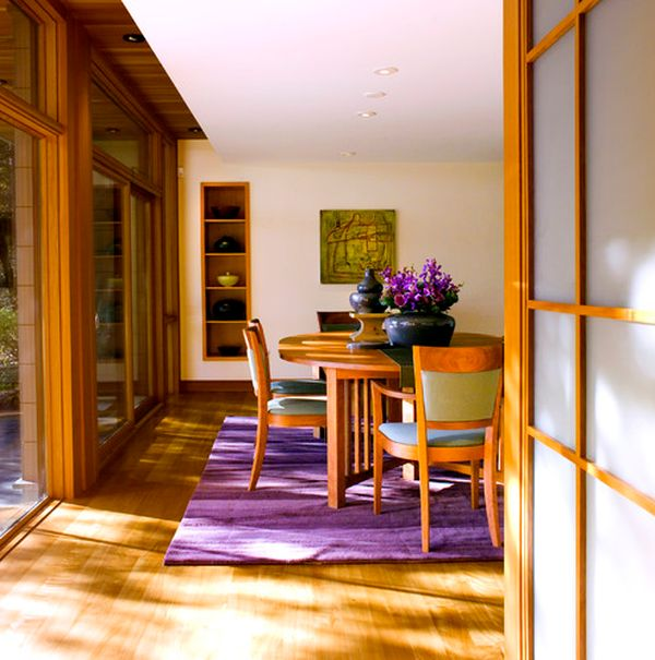 Fabulous dining room covered in wooden surfaces gets a fresh makeover with purple accents
