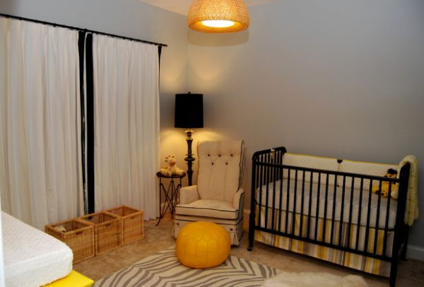 Gorgeous nursery with floor lamp in the corner sporting black lampshade