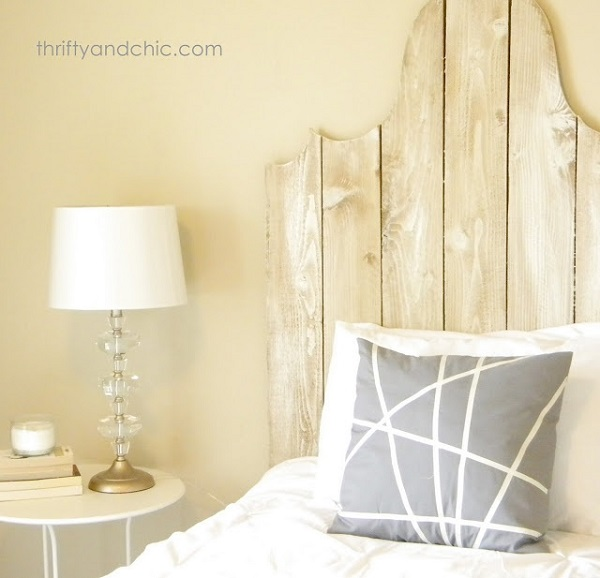 Gray and white pillow with crossed lines