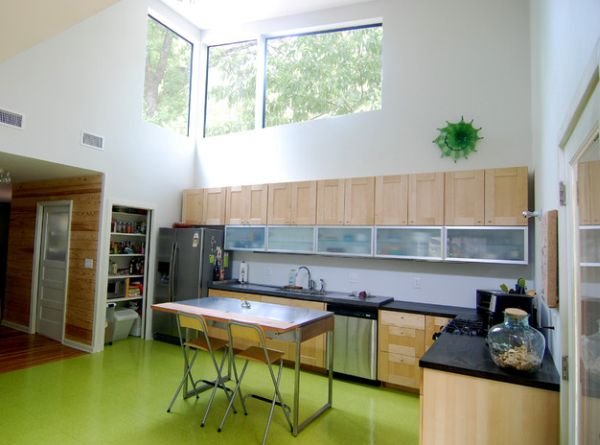 High gloss flooring in green presents a unique way to splash the kitchen with color!