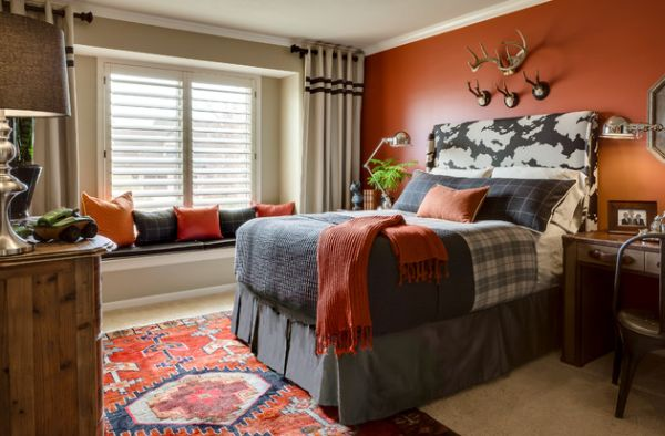 Kids' bedroom adds vivid color in the form of orange accent wall and accent fabrics