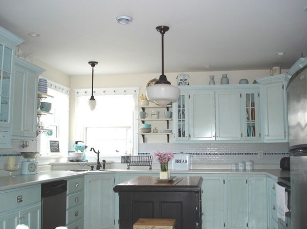 Kitchen in cool blue sports a small corner sink for Small kitchen designs with corner sinks