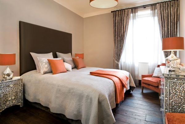 lampshades in orange light up this modern bedroom beautifully