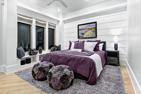 Lovely blend of various shades of purple and violet set against grey walls in the bedroom
