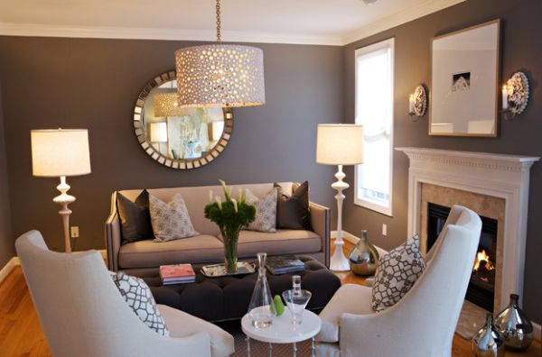 Lucille floor lamps on either side of the sofa along with a multitude of metallic floor vases add glitter to this room
