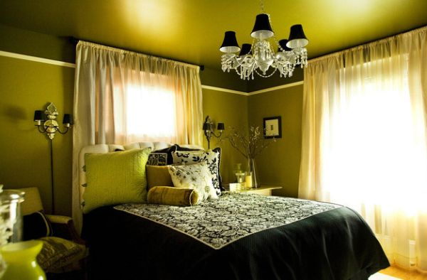 Luxurious bedroom in green uses conical lampshades in black