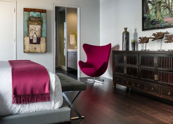 Magenta Egg chair in the corner pops out proudly in this contemporary bedroom