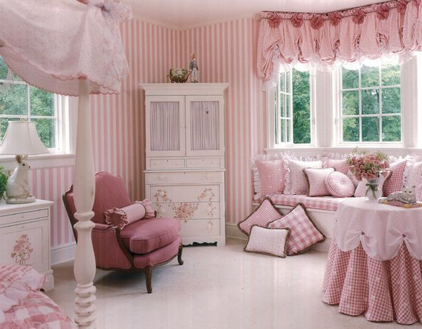 Matching drapes and pillow covers add to the glam factor of the pretty pink style