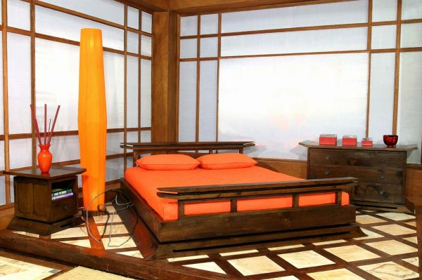 Minimalist bedroom in orange with overwhelming wooden textures around
