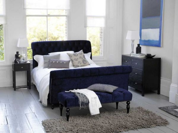 modern bedroom in dark blue and white