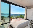 Modern bedroom with a stunning view thanks to sliding glass doors