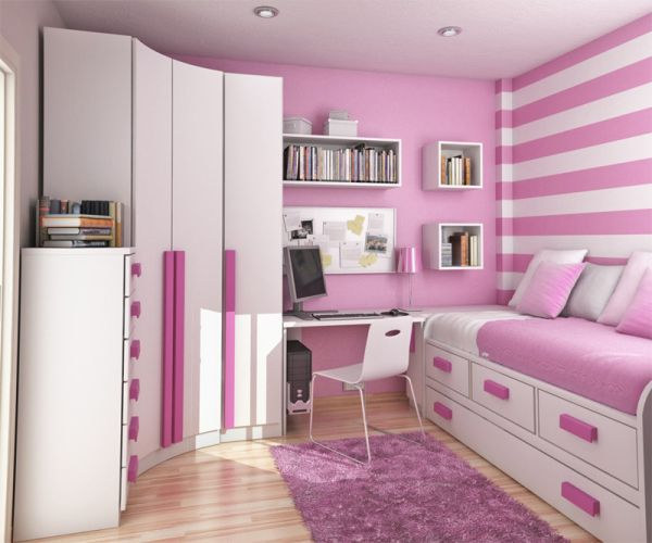 Modern girls' bedroom with white cabinets and striped backdrop