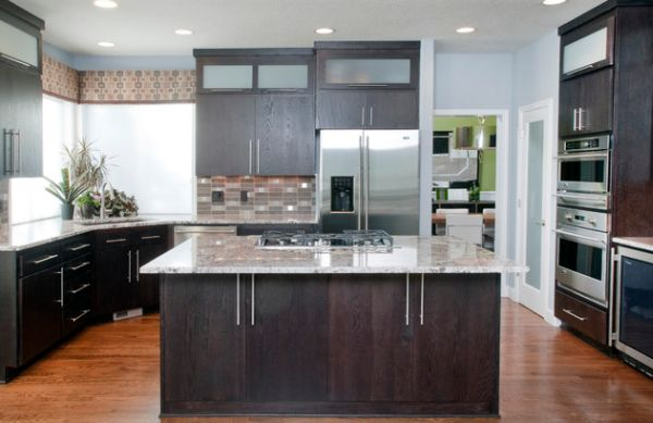 Modern kitchen with dark oak cabinetry and a compact sink in the corner