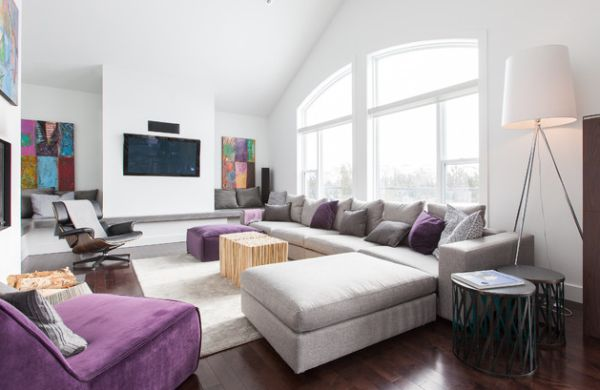 Modern living room in grey with a balanced addition of purple