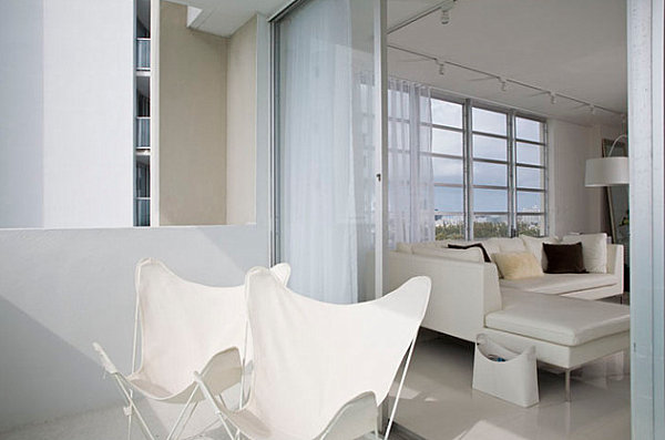 Modern white chairs on a Miami balcony