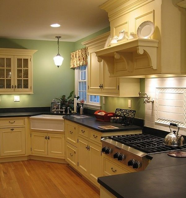 Multi level traditional kitchen with a daft little corner for Small kitchen designs with corner sinks