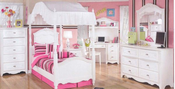 Numerous storage units help keep the mess at bay in this cute girls' bedroom