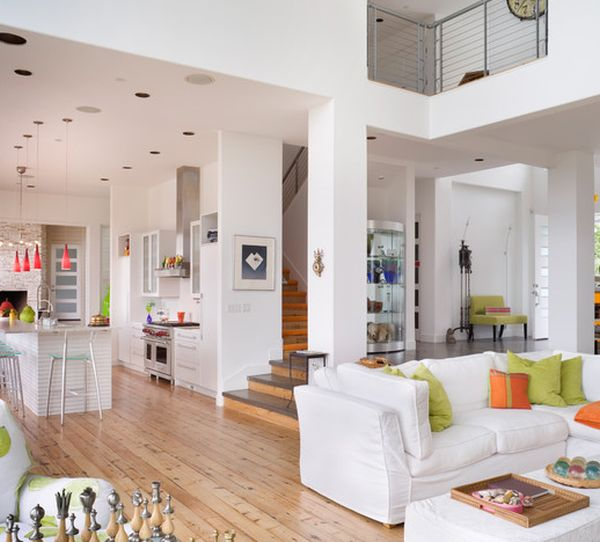 Open floor plan uses orange and green along with white