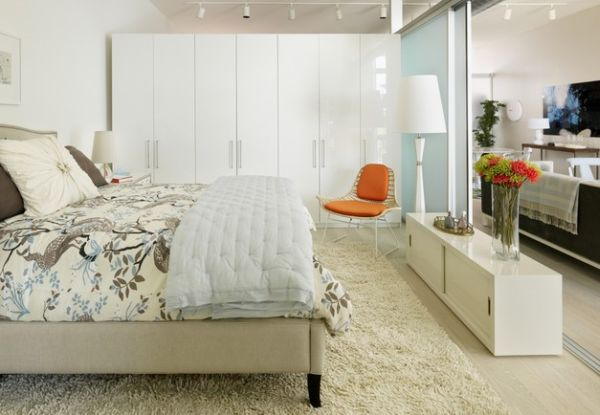 Orange accent chair set against white and pale blue backdrop is a chic and trendy choice