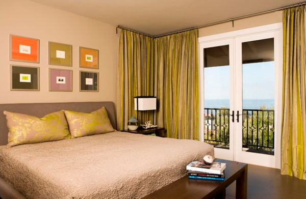 Orange and green bedroom with interesting and innovative use of drapes