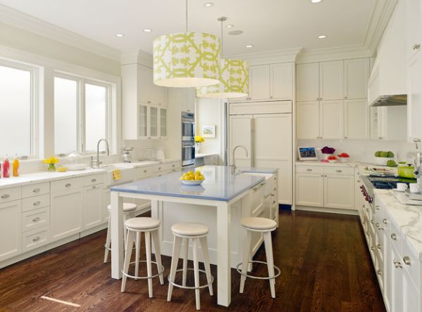 Pendant lights above the kitchen island and some fresh apples bringing the green!
