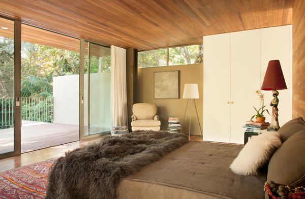 Plush bedroom separated from the balcony using sliding glass doors