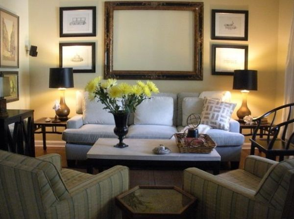 Plush couch in neutral hue flanked by table lamps sporting black lampshades
