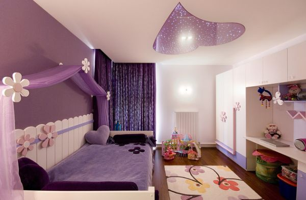 Purple accent wall in the girls' bedroom- Just as pretty as pink!