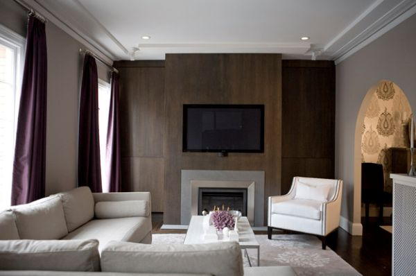 Purple drapes bring sophistication to this stylish living room in muted tones