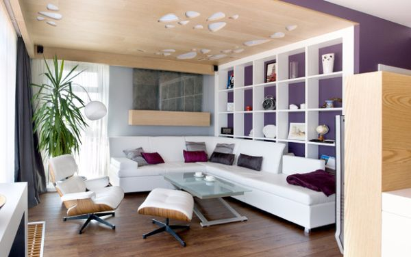 Purple on the walls and the Eames Lounger add elegance to the space