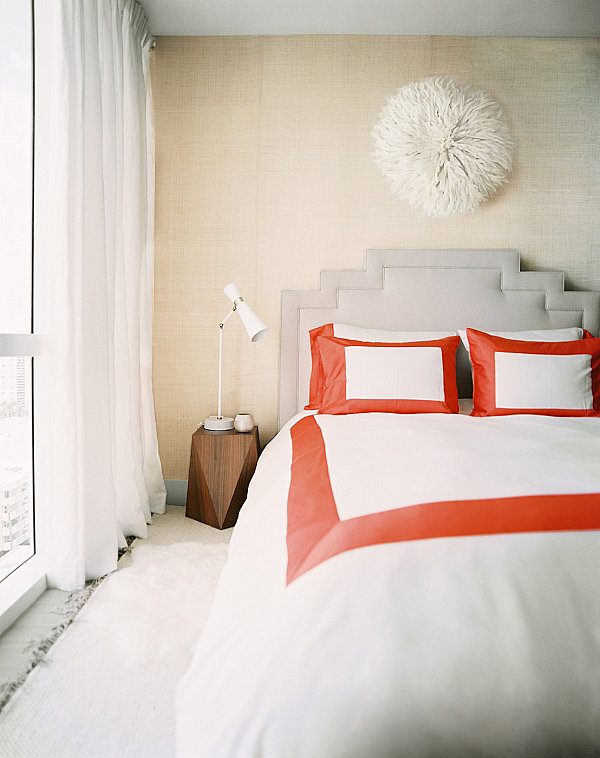 Red pops in a luxe modern bedroom