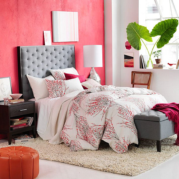 Red wall color and duvet cover accents