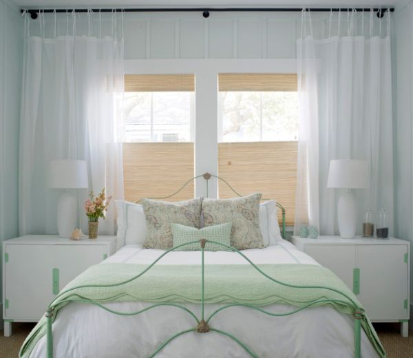 Refreshing bedroom largely in white presents a soothing atmosphere