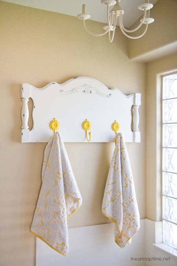 Repurposed headboard towel rack with yellow flower hooks