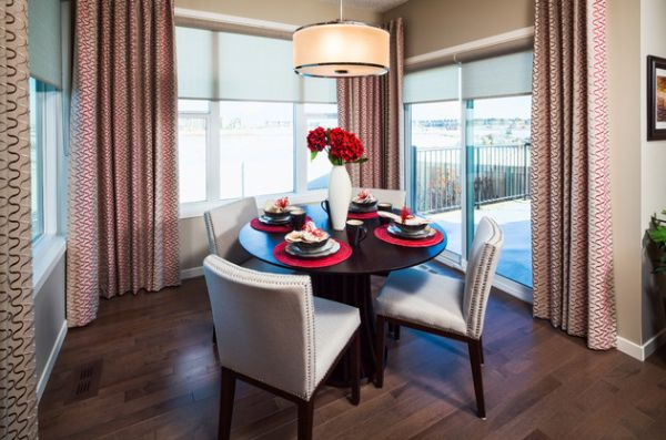Roller shades combined with drapes offer ample privacy and wonderful insulation